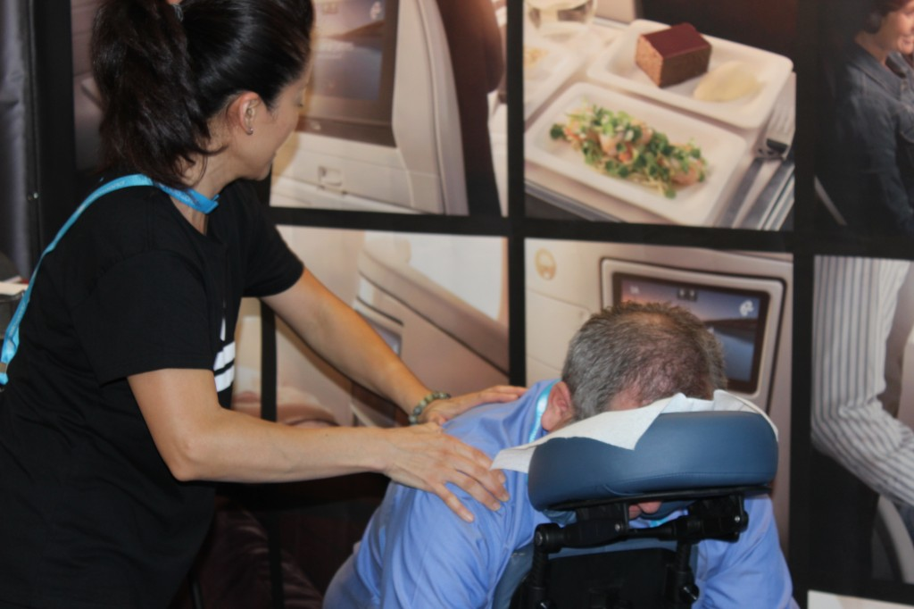 Akiko Takahashi, a senior therapist for Body Charge working at the Air New Zealand Booth, Sept. 2014
