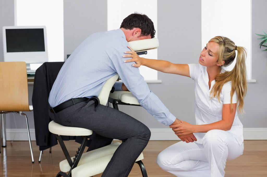 Office Chair Masseuse Giving Employee Massage